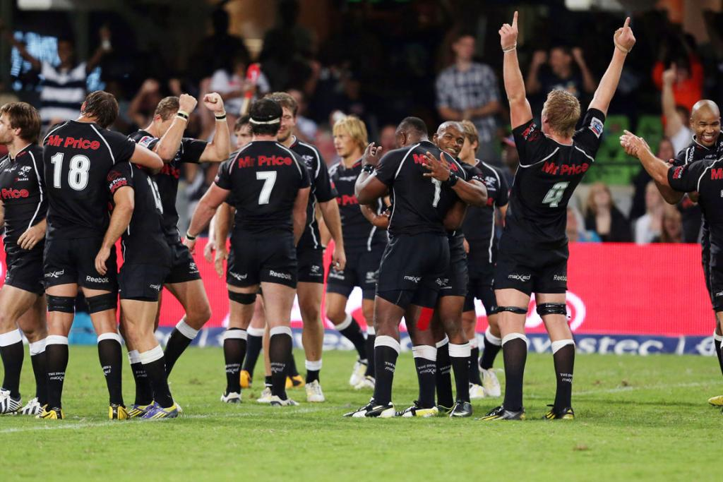 The Sharks celebrate their win over the Crusaders in Durban.