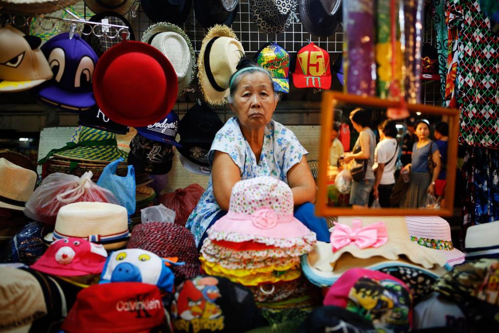 Souvenirs are offered to tourists visiting the Amphawa floating market at Samut Songkhram province.
