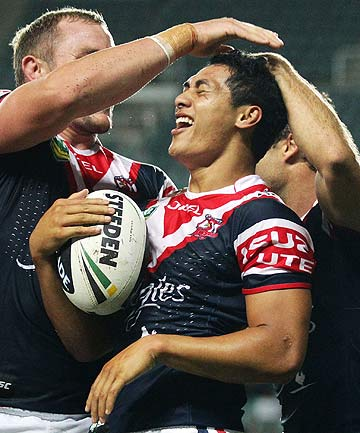 AT LAST: Roger Tuivasa-Sheck, centre, celebrates with teammates after scoring a try against the Eels.