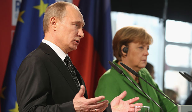 Vladimir Putin and Angela Merkel