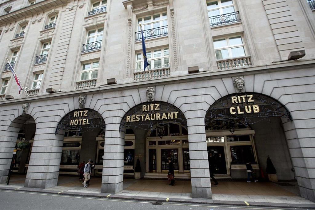 A pedestrian walks past the Ritz Hotel, where former Prime Minister Margaret Thatcher had been living, in central London.