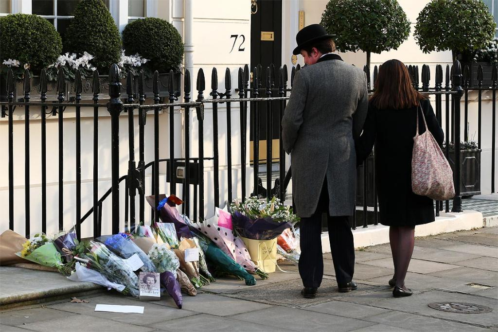 Flowers are left outside the London home of former British prime minister Margaret Thatcher after the announcement of her death.