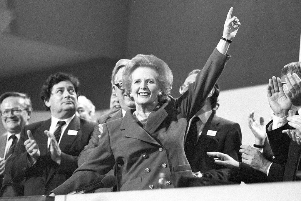 Then-British Prime Minister Margaret Thatcher points skyward as she receives standing ovation at Conservative Party Conference in October 13, 1989.