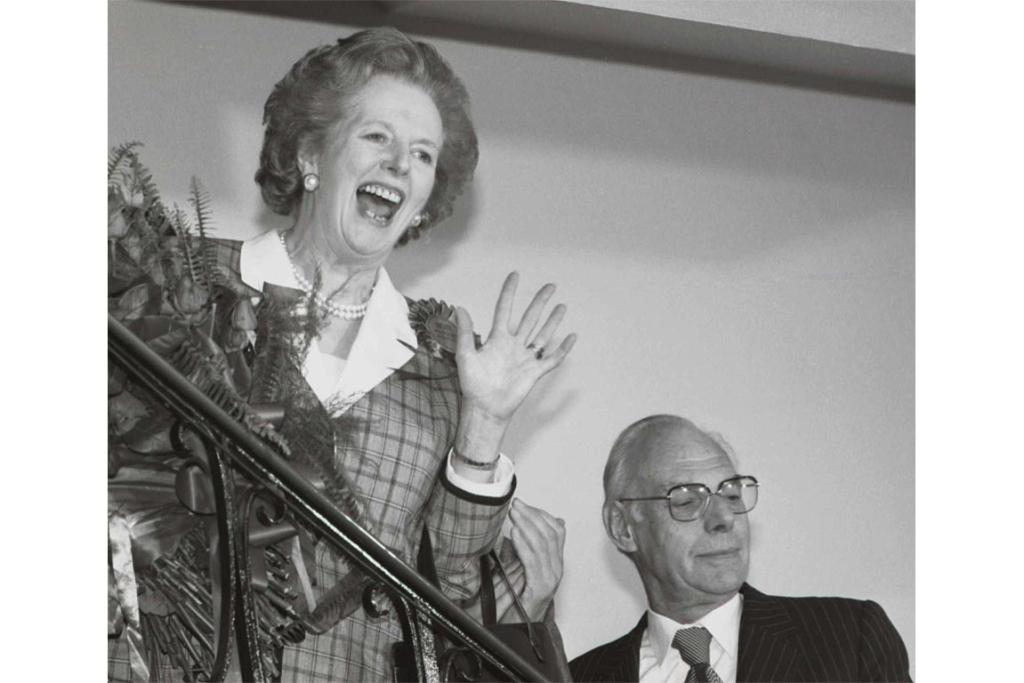 Margaret Thatcher gives a jubilant wave from the stairs inside her Conservative party headquarters in London early in June 12, 1987, after sweeping back to power for a third consecutive term of office after the general election.