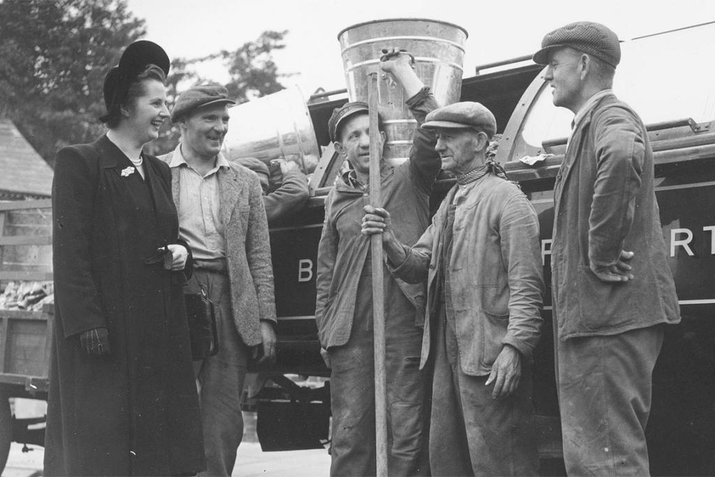 Margaret Thatcher - when she was Margaret Roberts - Conservative candidate for Dartford, Kent and youngest woman candidate in the election, talking to dustmen during her election campaign in October 4, 1951 in England.