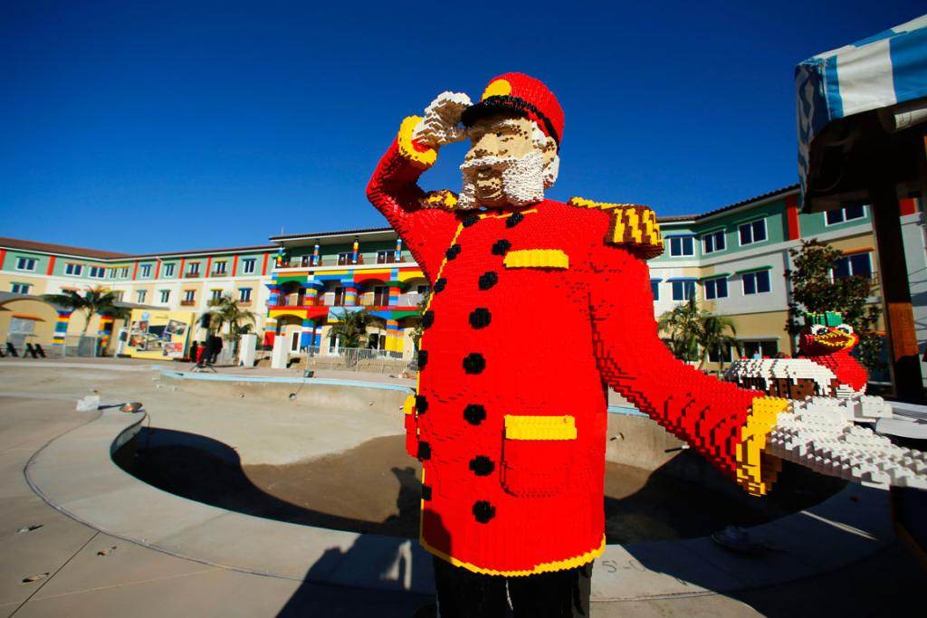 One of hundreds of Lego figures is seen by a pool in North America's first ever Lego Hotel in Carlsbad, California.