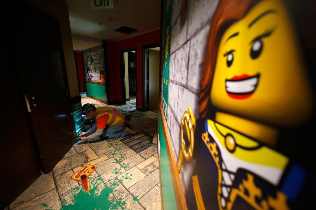 A craftsman works in the hallway during the construction phase of the Lego Hotel.