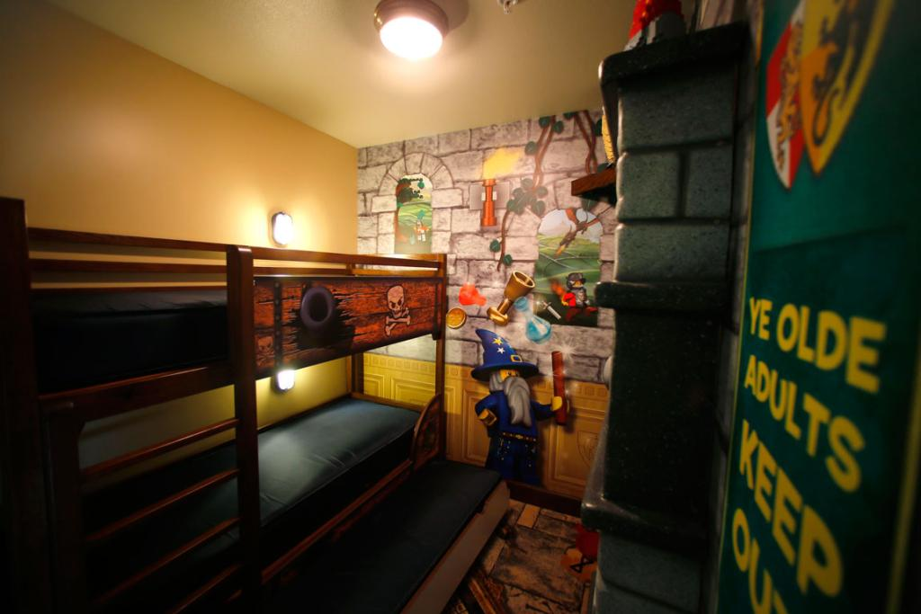 A separate kids sleeping area is shown in one of the hotel rooms.