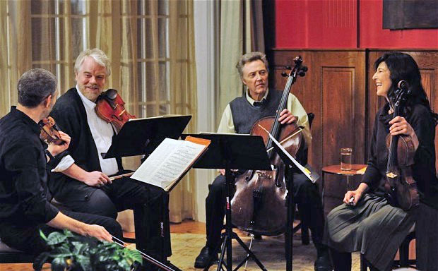 CLOSE TIES: The fictional Fugue String Quartet, played by Mark Ivanir, left, Philip Seymour Hoffman, Christopher Walken and Catherine Keener.