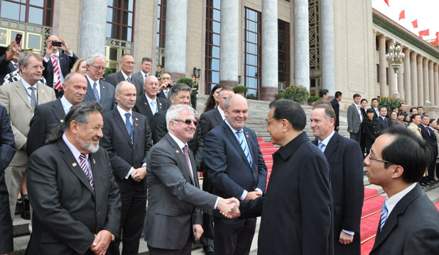 John Key introduces China Premier Li Keqiang to the New Zealand delegation at the Great Hall of the People in Beijing. He is shown here shaking Tim Groser's hand.