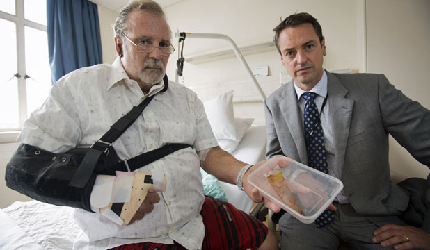 LUCKY ESCAPE: Glenn Abel with orthopaedic surgeon Angus Wickham. Mr Abel has had a 15cm piece of glass removed from his neck after a workplace accident that nearly killed him.