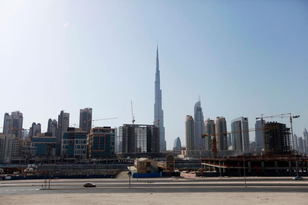 Construction cranes are seen near Burj Khalifa.