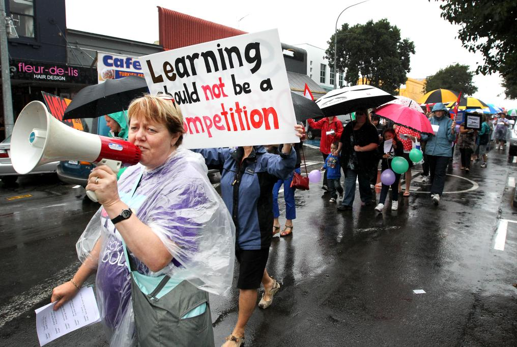 PROTEST: Judith van Kooten from NZEI Primary Teachers Leadership team helps lead the chants during the protest in New Plymouth.