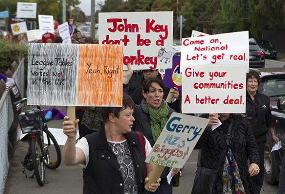 PROTEST: Teachers and parents take part in the protest held on Devon Street, New Plymouth.