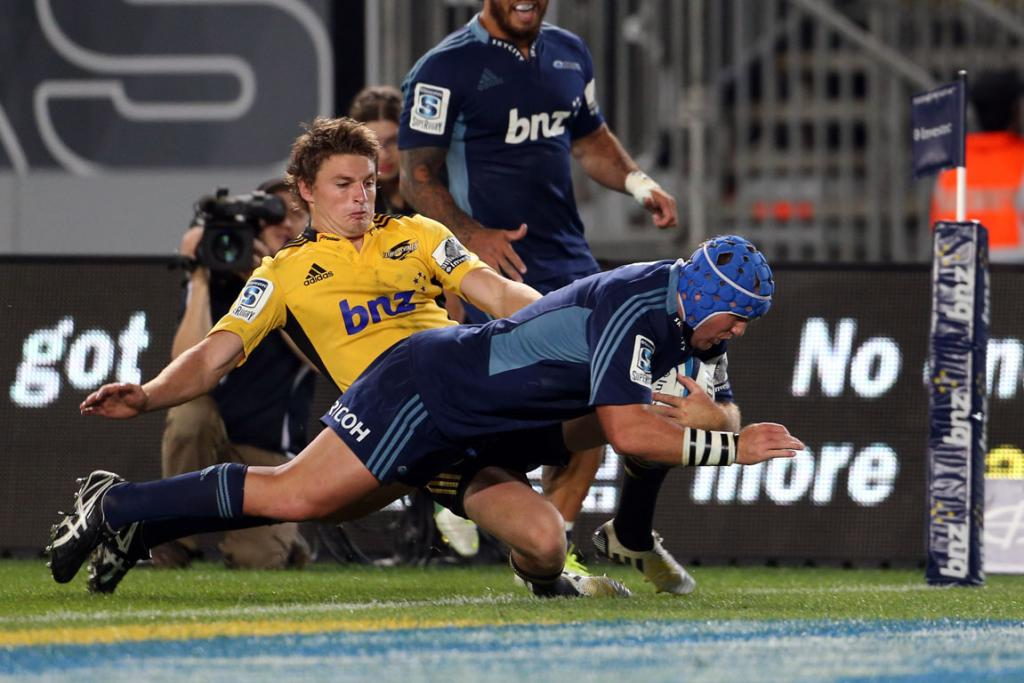 James Parson gets past Beauden Barrett to score for the Blues.