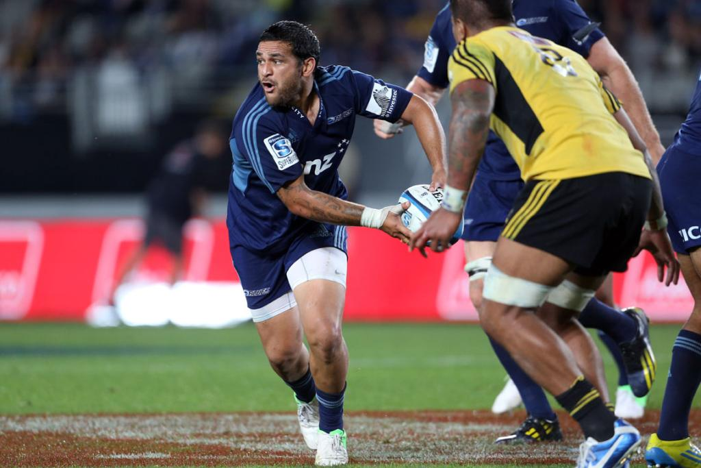 Piri Weepu gets a pass off as the Blues beat the Hurricanes at Eden Park.