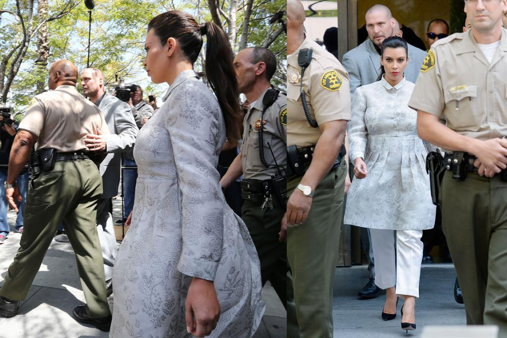 THE BAD: I love this picture so much. It's like Kim K is the leader of the bad, well-groomed people in The Hunger Games universe and she's en route to a stadium to pick out which children are bad for ratings and should be hurried along.