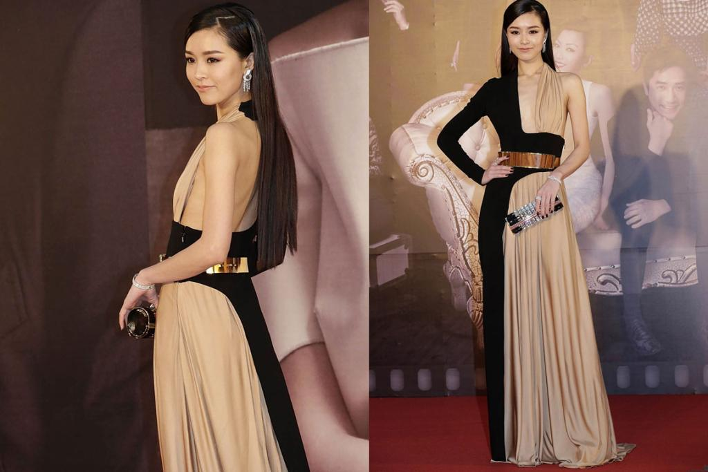 THE GOOD: Janice Man, a model and actress from Hong Kong, completely rocks this Stephane Rolland two-tone draped gown. The only slight switch-up I'd make would be gold rather than silver accessories.