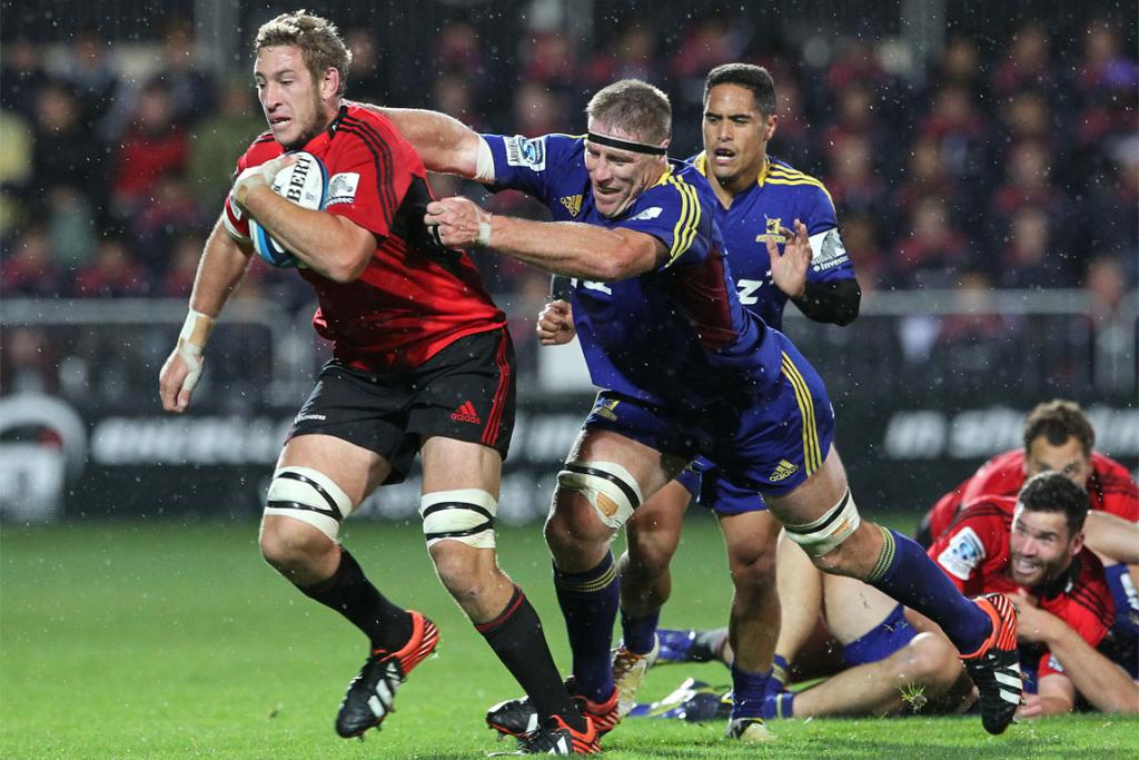 Brad Thorn snares Luke Romano in a tackle.
