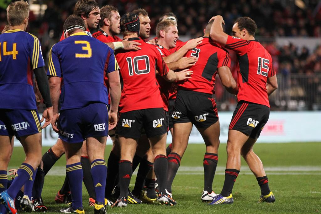 The Crusaders celebrate after scoring a try against the Highlanders.