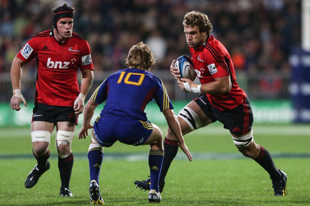 Luke Whitelock charges into the Highlanders defence.