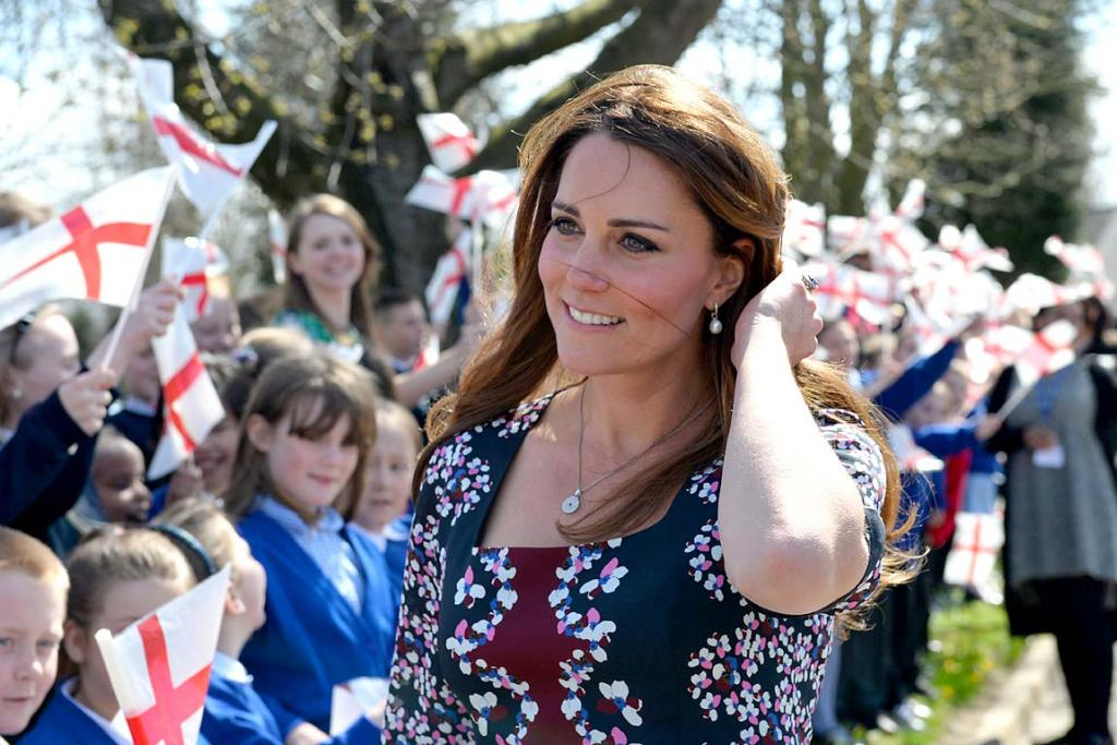 Children cheer as a glowing Kate Middleton visits Willows Primary School.