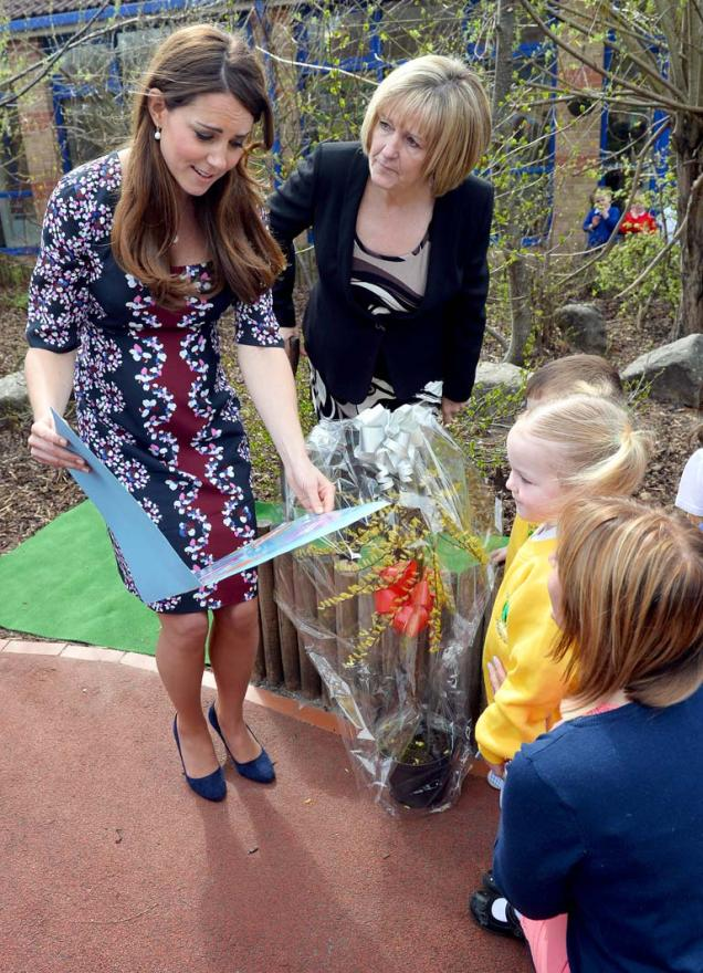 Children present the duchess with a book entitled What do Princesses do?