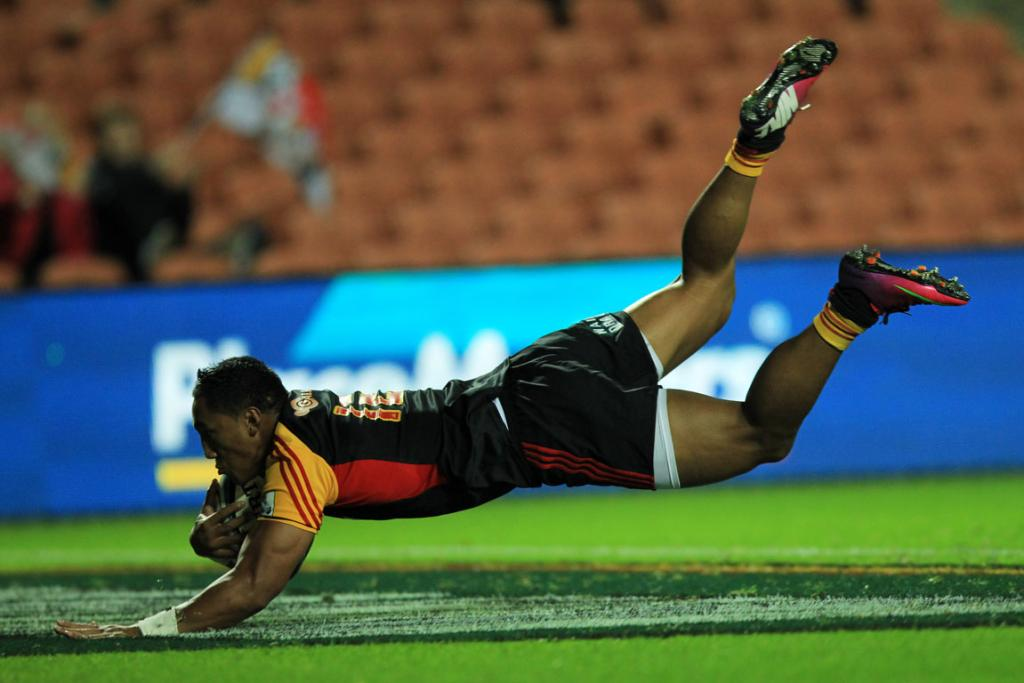 Bundee Aki dives over for a try during the Chiefs win over the Sharks at Waikato Stadium.