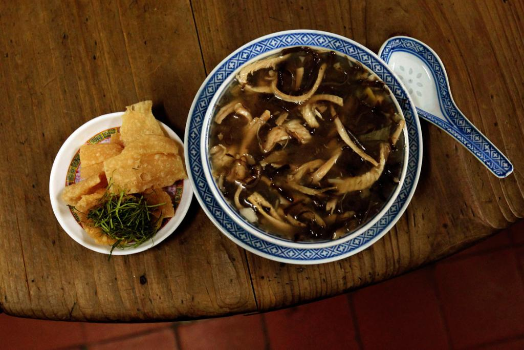 Snake meat in a bowl of snake soup served at a snake soup shop in Hong Kong.