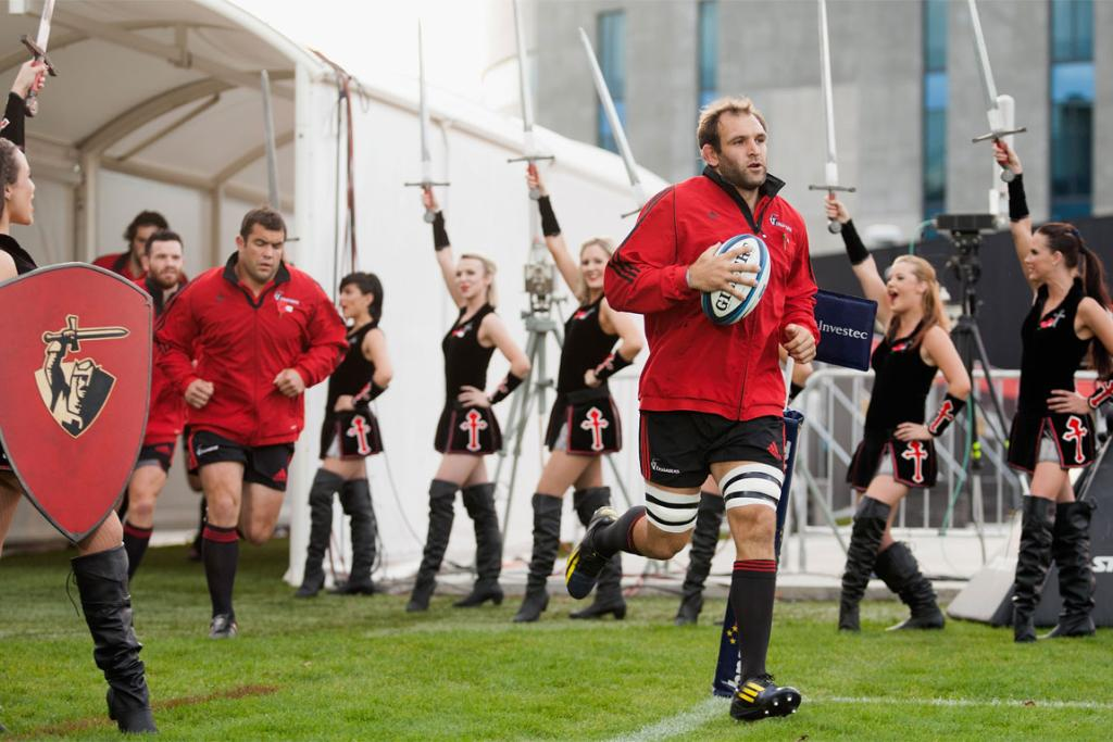 George Whitelock leads the Crusaders on to AMI Stadium for the game against the Rebels.