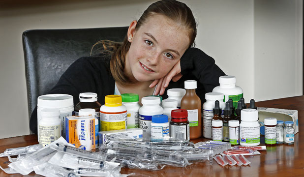 COSTLY COCKTAIL: Ruby Penney, from Pukerua Bay, has Lyme disease and must take all this medication daily.