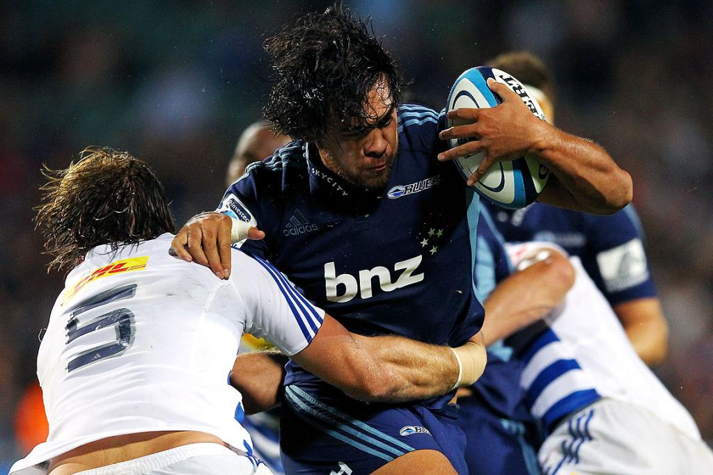 Steven Luatua of the Blues charges into the Stormers' Andries Bekker during their clash at North Harbour Stadium.