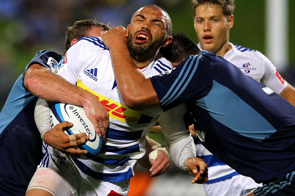 Bryan Habana of the Stormers is smashed by the Blues defence during their Round 12 clash.