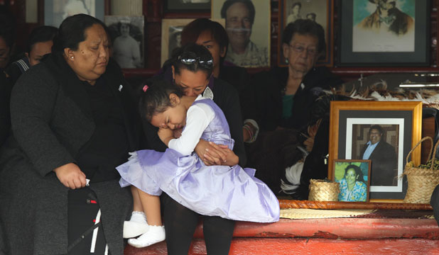 Family gather at MP Parekura Horomia' tangi. His grand daughter Te Rau O Te Huia is held by her auntie Lenora Roberts and his daughter in law Robin Horomia.