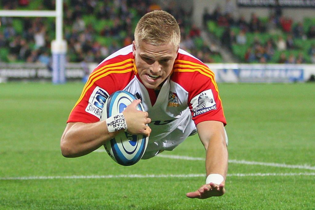 Gareth Anscombe goes in to score against the Melbourne Rebels.