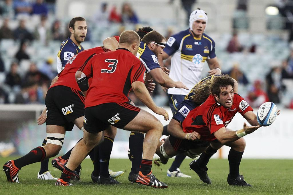 Sam Whitelock gets a pass away in the tackle.