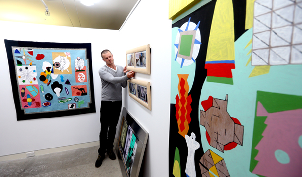 """BIG FOLLOWING: James Blackie hangs works by late Wellington artist Gordon Crook at Page Blackie Gallery. """"People who are fans are huge fans,"""" he says."""