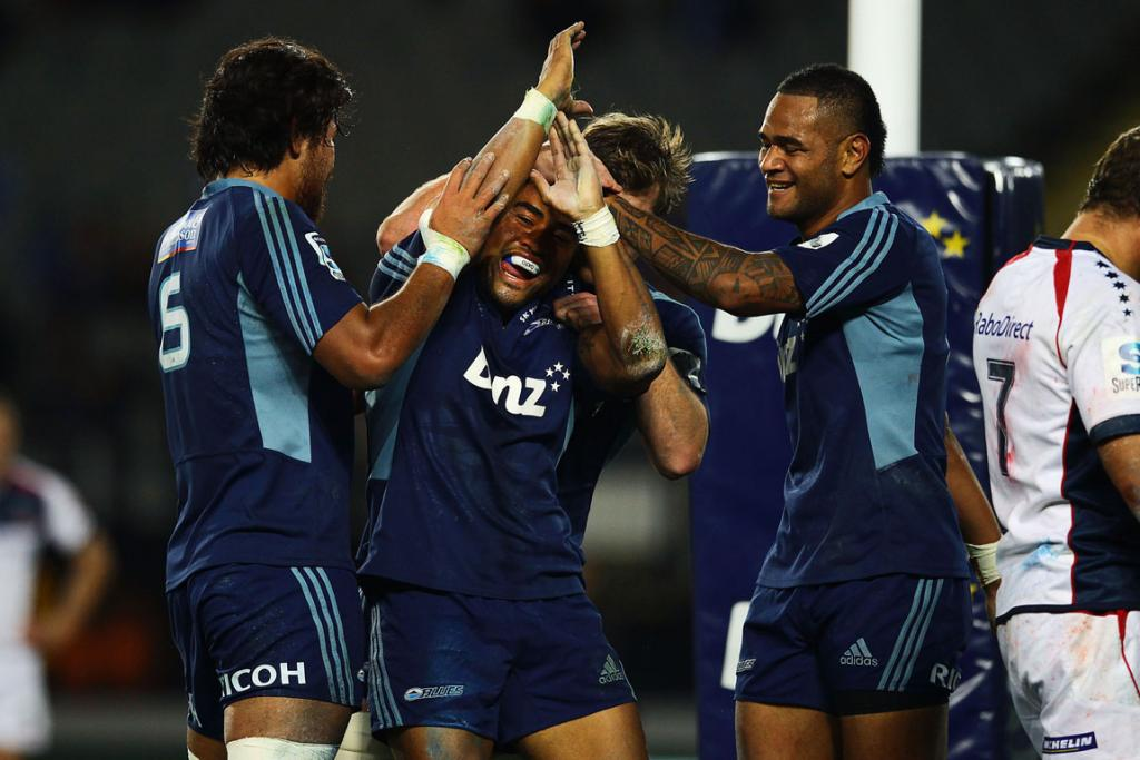 Francis Saili is mobbed by teammates after scoring a try during the Blues' win over the Cheetahs.