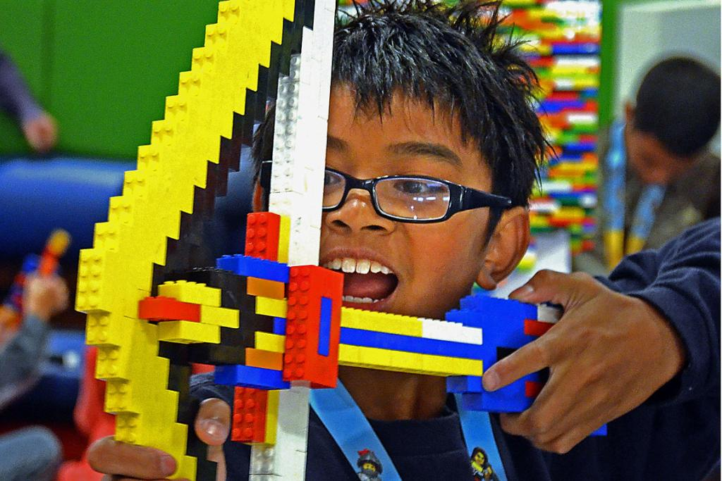 Mason Eugenio, 11, plays with a bow he made from Lego pieces.