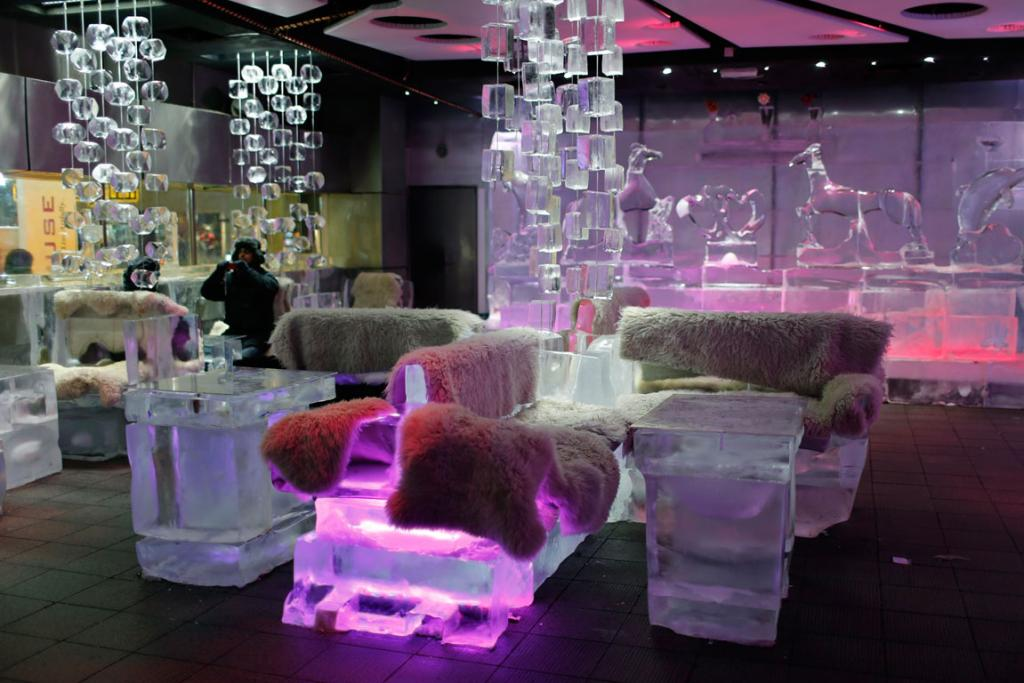 The cafe, with its illuminated interiors, curtains, paintings and seating arrangements, is all made of carved ice and frozen sculptures. P