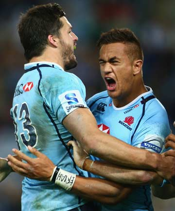 MATCH-WINNER: Peter Betham celebrates his match-winning try in the 72nd minute with Adam Ashley-Cooper.