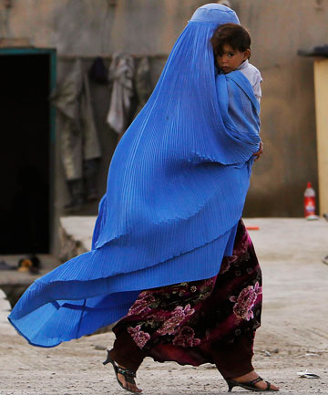 An Afghan woman with her child on the outskirts of Kabul