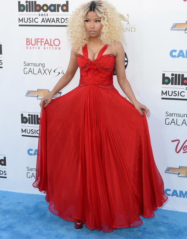 Nicki Minaj does her best to impersonate a Disney princess on the red carpet...