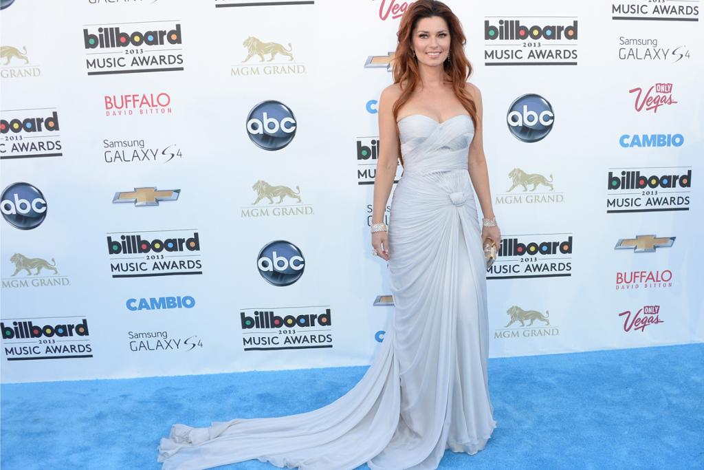 Man, I feel like a woman (who has come to an awards ceremony in a wedding dress). This Pavoni by Mikael D gown is not Shania Twain's finest moment, but she's worn plenty worse in her time.