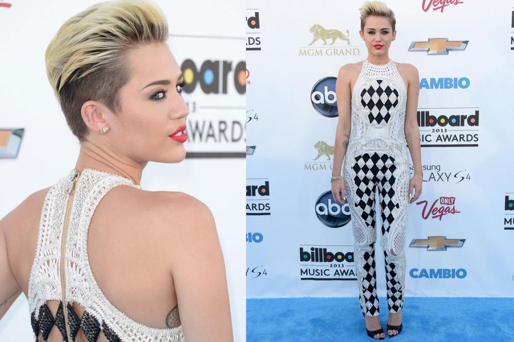 Miley Cyrus wears a baroque harlequin-style Balmain jumpsuit, and, contrary to almost all of my style morals, I actually don't hate it. It's a music awards show, which is a licence to go a bit crazy, and Miley's only 20. So yeah, why not dress up in a giant crochet-sequined doily chequered flag hybrid that probably cost more than six months rent.