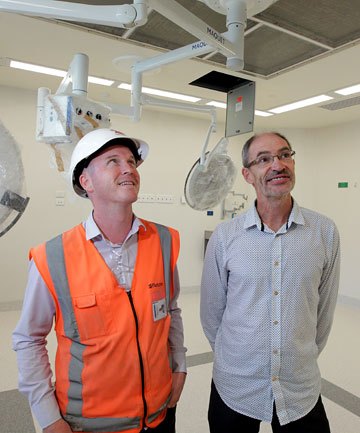 HANDOVER: Fletcher's Chris Goldsbury, left, and Taranaki Base Hospital redevelopment manager Steve Berendsen in one of six new operating theatres officially completed yesterday.