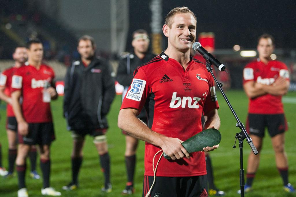 Andy Ellis talks to the crowd after being presented with a mere in recognition of playing 100 games for the Crusaders.