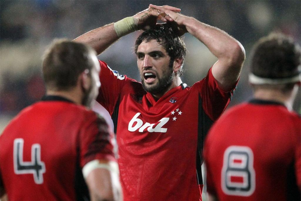 Sam Whitelock takes breather during the clash against the Blues.