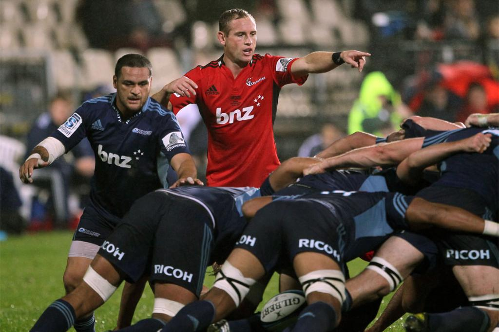 Piri Weepu is closely watched by opposite number Andy Ellis.