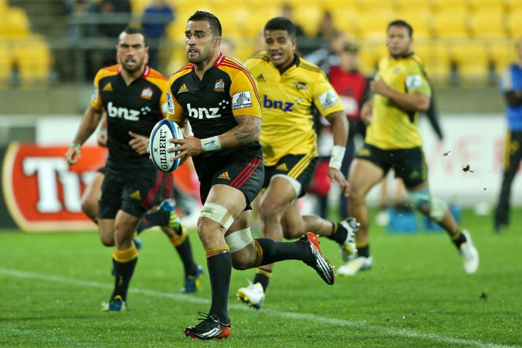 Liam Messam charges into the gap for the Chiefs against the Hurricanes.